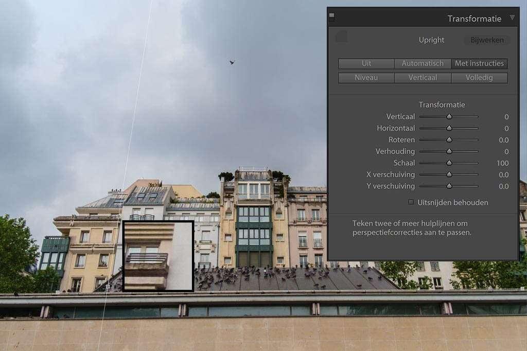 In het deelvenster Transformatie trek je bij Met Instructies de horizontale en verticale lijnen om de gebouwen rechtop te zetten.